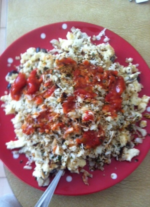 "egg whites, shredded cauliflower ""rice"", onion, mushroom, olives, salsa. Awesome 250 calorie diet meal."